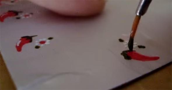 adesivo de unha pimenta com flor